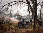 Cannons fire across the Rappahannock River into the City of Fredericksburg, during a reenactment of the Battle of Fredericksburg, VA. 2012