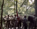 Confederate re-enactors pause while forming in the woods for battle during a reenactment of the Seven Days Battles in Elizabethtown, PA. 2012