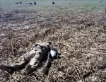 """Re-enactor lies """"dead"""" during a reenactment of the Battle of Vicksburg  in Raymond, MS. 2012"""