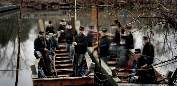 Pontoon boats carry Union reenactors into the battle at Fredericksburg 2012