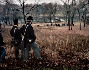 Union re-enactors watch as a pontoon bridge across the Rappahannock is readied during a reenactment of the Battle of Fredericksburg, VA. 2012