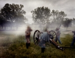 Confederate guns fire at the reenactment of the Battle of Chancellorsville, 2013.