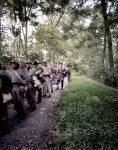 Confederate troops pause on the forest during a Seven Days Battles reenactment. 2012