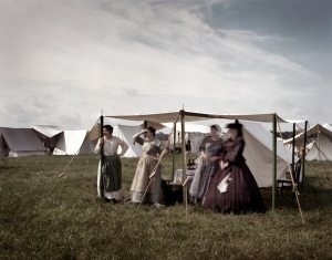 Gettysburg girls wave to the passing troops on the Bushey Farm, Gettysburg. 2013