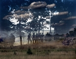 "Two battles captured inadvertently in this double exposure. Union troops defend ""Little Round Top"" and fighting in the ""Wheat Field"" at bottom right, during a reenactment in Gettysburg."