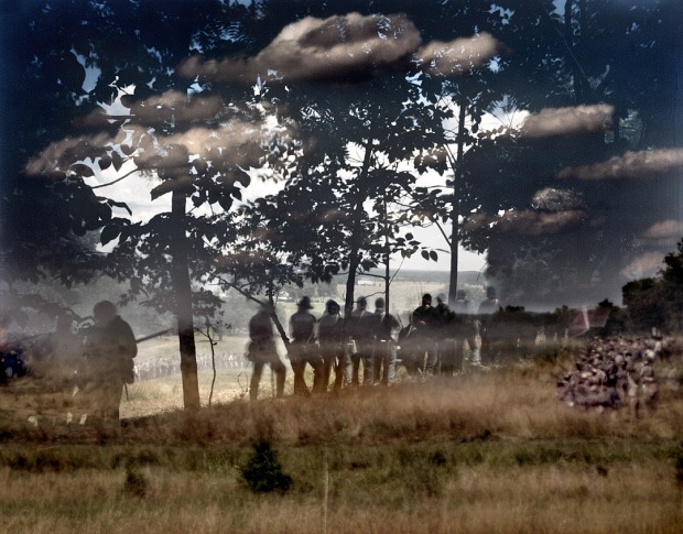 "Two battles captured in this double exposure. Union troops defend ""Little Round Top"" and fighting in the ""Wheat Field"" at bottom right, during a reenactment on the Bushey Farm in Gettysburg, Pa 2013"