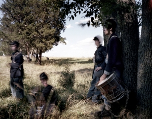 Drummer boys seek the shade during a reenactment of the Battle of Gettysburg. 2013