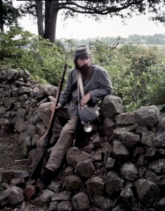 A Confederate reenactor at the rock wall along Seminary Ridge, Gettysburg, Pa. 2013