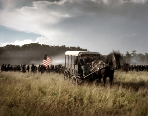 Horse drawn ambulance in the field during a reenactment of the Battle of Gettysburg. 2013