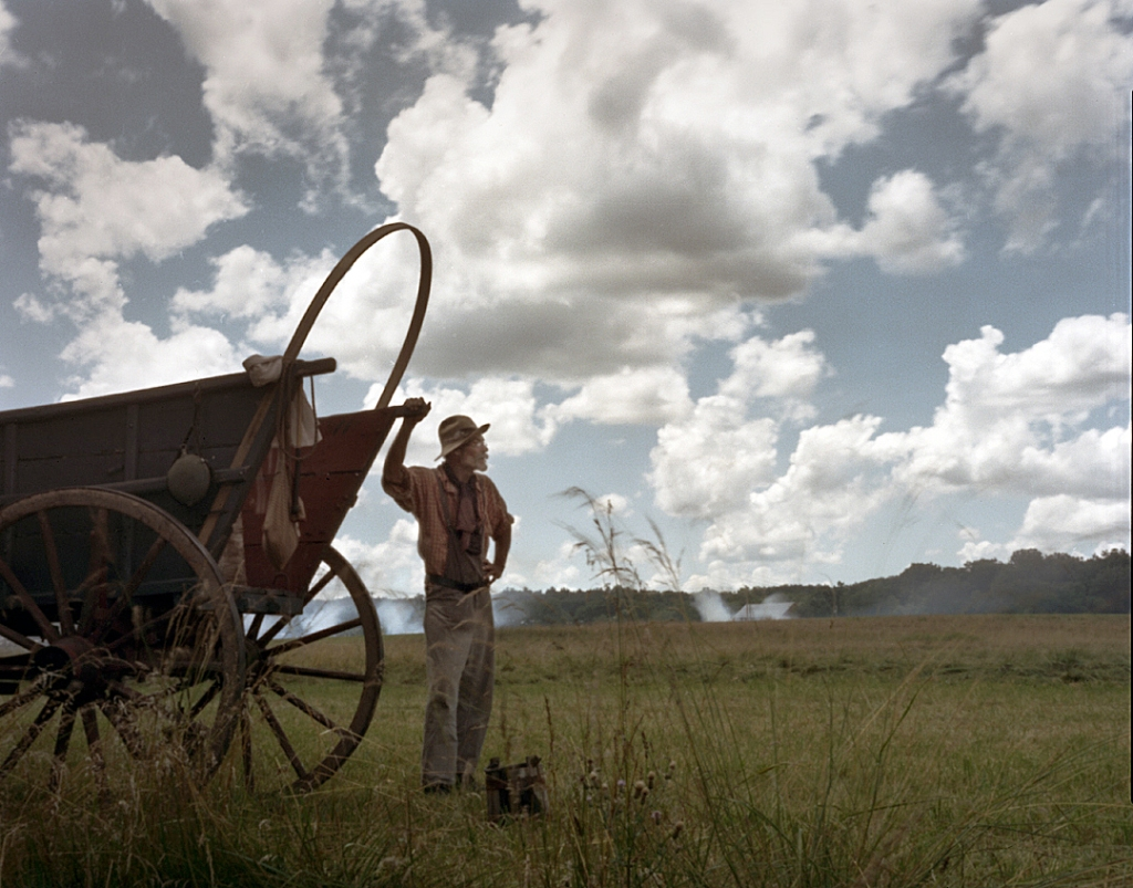 Wagoneer waits for the sounds of battle during a reenactment of the Battle of Gettysburg, Pa. 2013