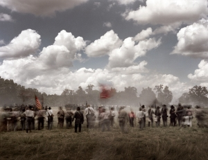Confederate troops on the attack during a reenactment of the Battle of Gettysburg. 2013