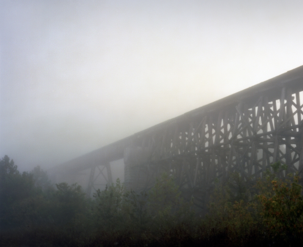 Morning fog shrouds a train trestle spanning the Red River in Clarksville, TN 2013.