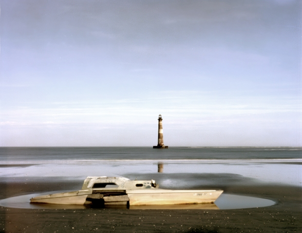 A sailboat wrecked and a lighthouse stranded at sea testament to the storms and shifting sands of Morris Island, SC 2013