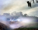 Cannon smoke lingers during a reenactment of the Battle of Fort Wagner at Boone Plantation, SC 2013