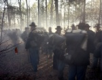 Reenactors form up amongst gun smoke filled woodland in Mosely, Va 2014