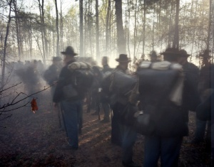 Reenactors form up amongst gun smoke filled woodland in Mosely, Va 2014