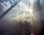 Reenactors march though a smoke filled landscape in Mosley, Virginia 2014