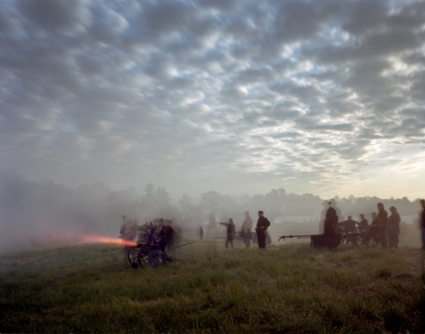 Cannons fire as the sun  rises in Spotsylvania County, Virginia 2014