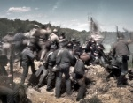 Union troops surge over the Confederate earthworks during a reenactment of the hand to hand fighting at the Mule Shoe Salient at Spotsylvania 150 years ago