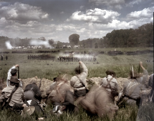 Union reenactors assault Confederates fighting from their earthworks during a reenactment of the Battle of Spotsylvania Courthouse