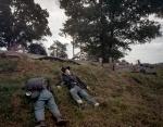 Reenactors in their death pose on Confederate earthworks at Resaca, Ga 2014