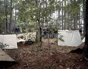 Union reenactors in Resaca bivouac in the forest forgoing the standard tent and sleep on the ground under tent-flies echoing Sherman's troops in 1864
