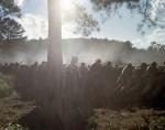 Confederate reenactors fight from behind earthworks in Resaca, 2014