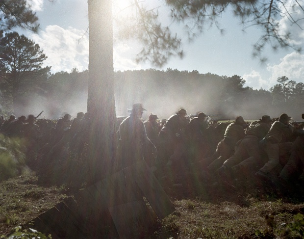 Confederate reenactors fight from behind earthworks in Resaca, 2014