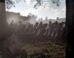 Reenactors fight from behind earthworks on the Battlefield at Resaca, Ga 2014