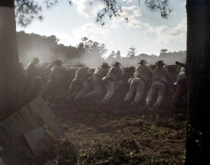 Reenactors fight from behind earthworks on the Battlefield at Resaca, Ga 2014