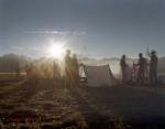 Reenactors stir with the rising sun in Henrico, Virginia 2014
