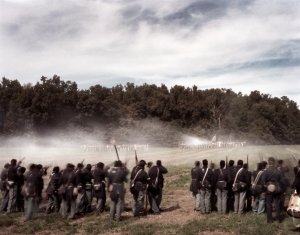 Reenactors representing the United States Colored Troops engage Confederates in Henrico, Va