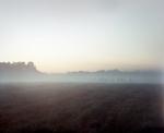 Gun smoke shrouds reenactors on an old Civil War battlefield near Richmond Virginia in 2014