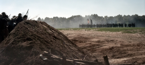 Union reenactors at right assault a reconstructed Fort harrison in Henrico, Va 2014