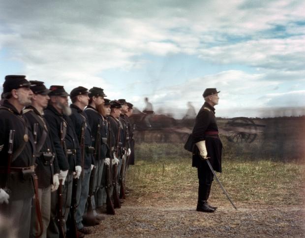 Horse-drawn artillery pass reenactors on parade at Cedar Creek