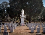 The monument of Silence looks over the graves of Georgian Confederates at Laurel Grove Cemetery