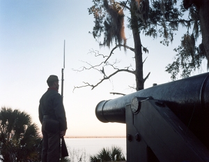 Reenactor stands sentry at Fort McAllister looking to the opposite bank of the Ogeechee River where the Union Navy anchored their ironclads to bombard the in 1863