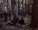 Reenactors lounge in the Georgia woods