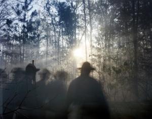 Reenactors move through the Virginia wilderness in Moseley, Va 2014