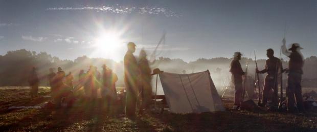 Confederate reenactors stir with the morning sun in Henrico County, Va 2014