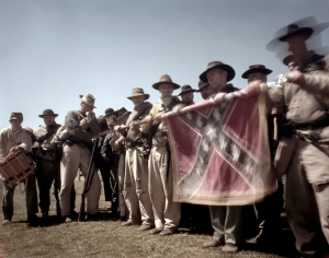 Members of the 4th Texas roll up their battle flag in the surrender ceremony at Appomattox 2015