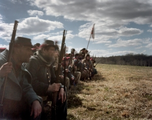 Confederate reenactors wait for the Union attack