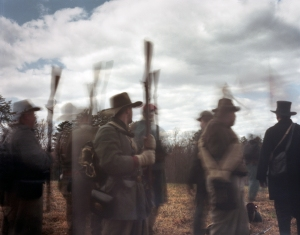 Confederate reenactors raise their rifles in a sign of capitulation at the 150th anniversary of the Battle of Sailor's Creek in Rice, Virginia 2015
