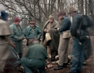 Confederate reenactors huddle around a fire on a cold spring morning in Rice, Va 2015