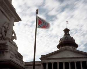 The Stars and Bars flies over a Confederate memorial at the South Carolina State House.