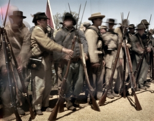 Confederate soldiers stack their arms at the 150th anniversary of the surrender at Appomattox, Va